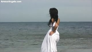 Young Pretty Lady Poses Naked by the Sea